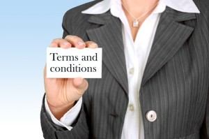 lady holding paper that says terms and conditions